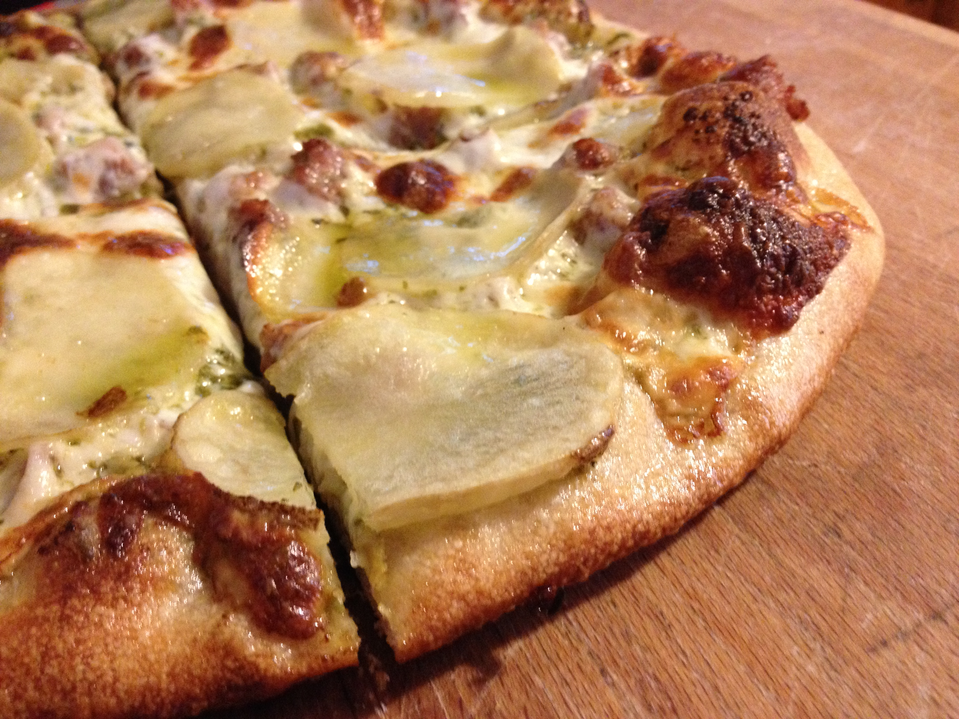 Pizza with sausage and potatoes