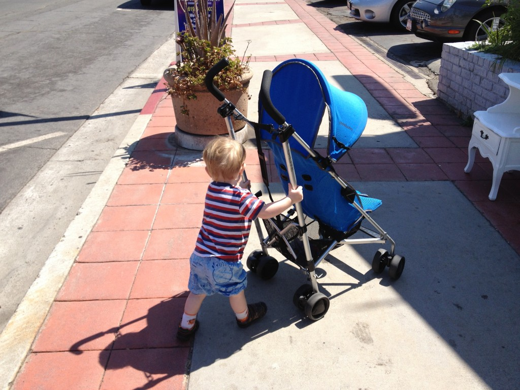 Number Two pushing stroller