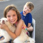 Kids and Oscar in wagon